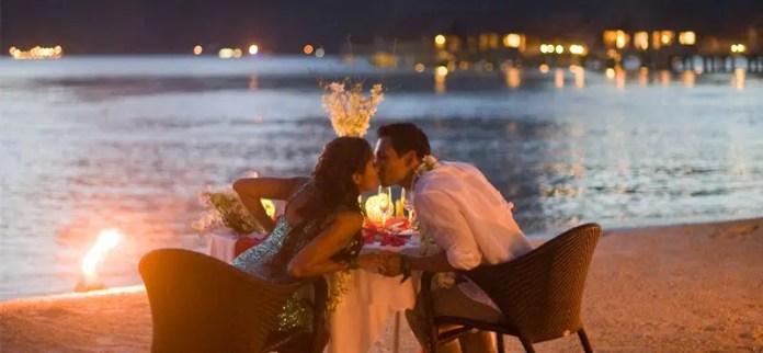 A couple having dinner on a private beach