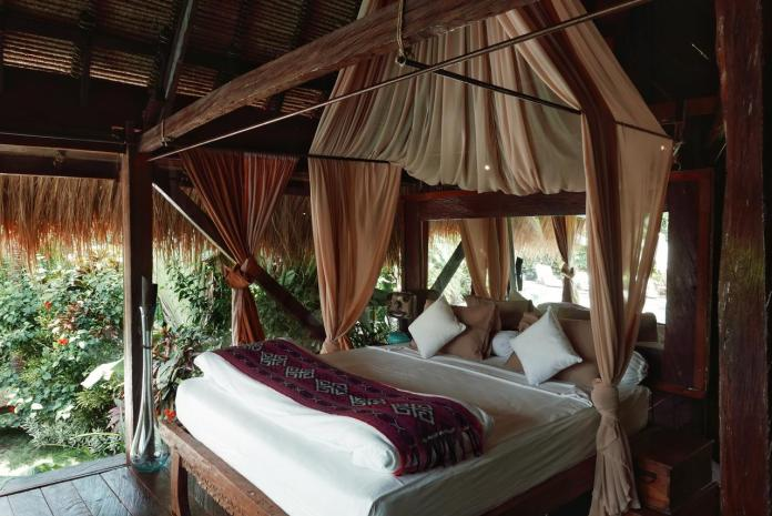 The canopied bedframe at Own Villa Bali is completely handmade