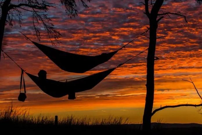 hammocks and sleeping bags at sunset
