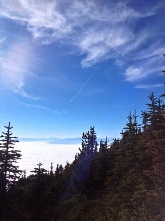 Jet stream, bluebird sky, sun flare and the cloud inversion