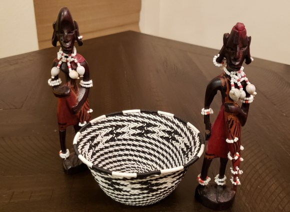 wooden dolls and woven metal baskets from Greenmarket Square