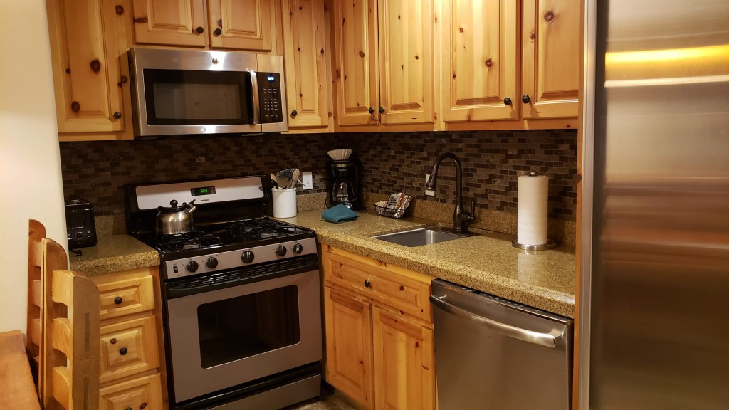 The full kitchen with appliances