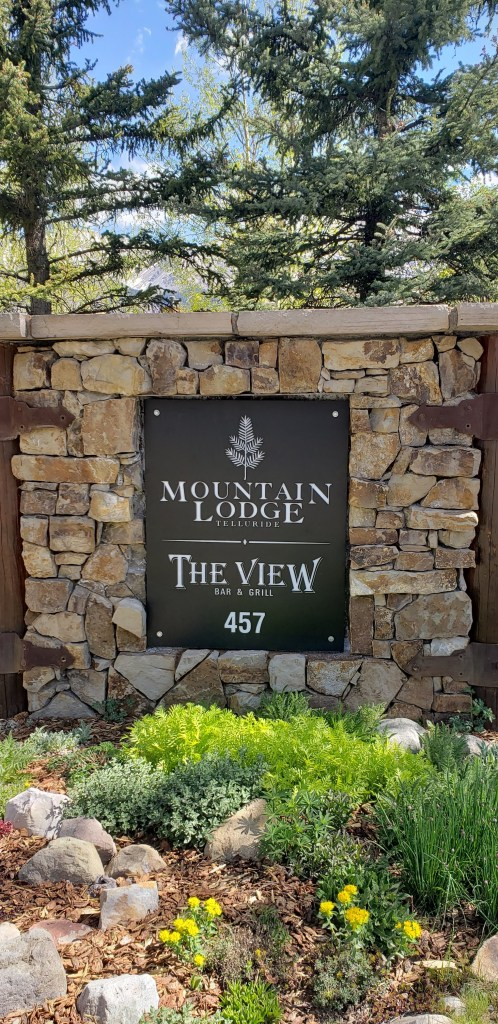 The front entrance to the Lodge with a stone encrusted sign