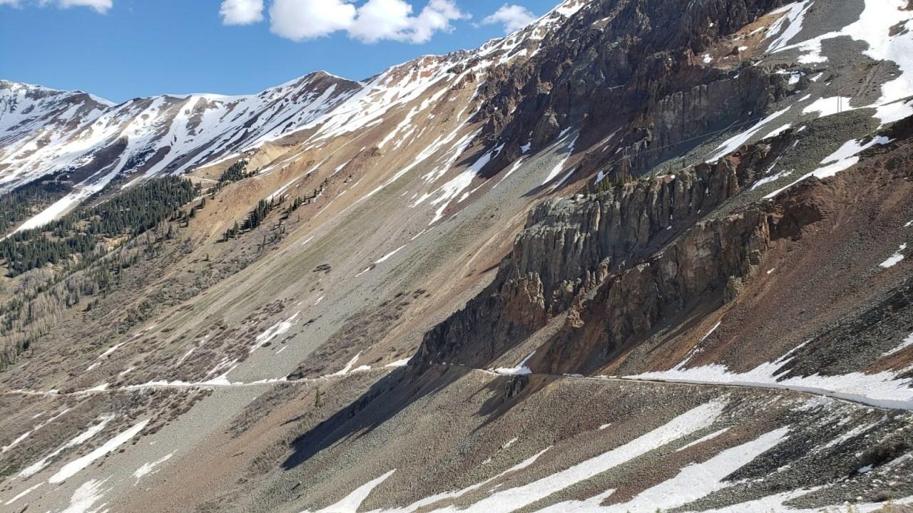 Narrow road along cliffside to Ophir Pass