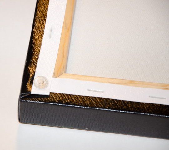 Bottom corners of canvas prints have plastic stops to protect surfaces and make for straighter alignment