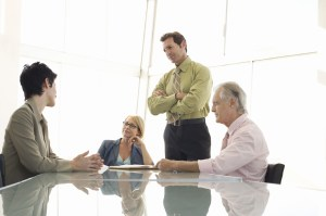 http://www.dreamstime.com/royalty-free-stock-images-business-people-having-discussion-conference-table-listening-to-female-executive-meeting-image31826809