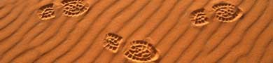 Footsteps in desert sand