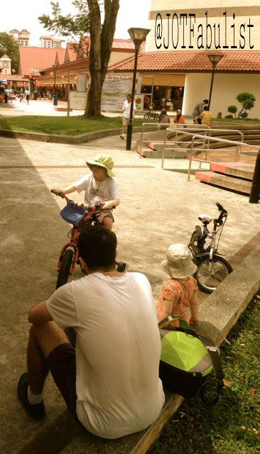 Riding the new bike through the heartlands of Singapore.