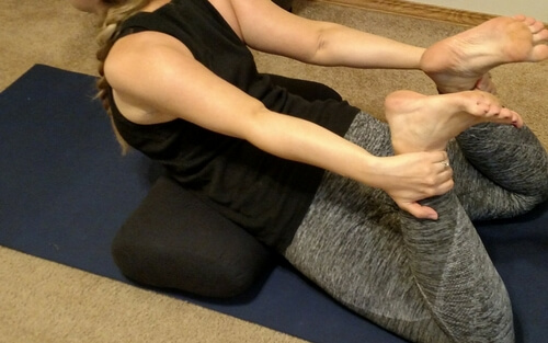 Using yoga bolsters for supported bow pose