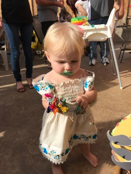 She had more fun playing with the cake topper than she did eating the cake.