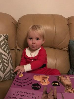 This girl loves her books!