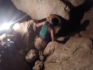 Tess climbs down a narrow hole.