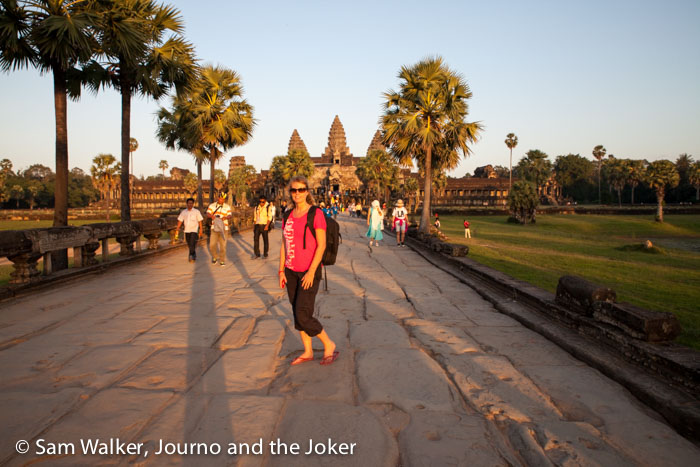 Sam in front of Angkor Wat at sunset