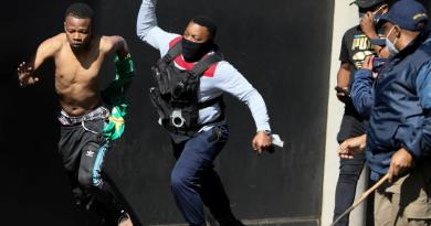 Violence spreads to South Africa's economic hub in wake of Zuma jailing, in Johannesburg
