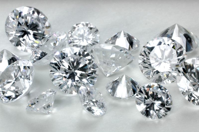 Round brilliant polished diamonds.