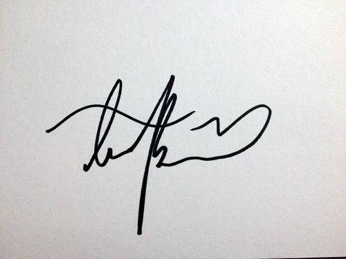 Troian Bellisario autograph