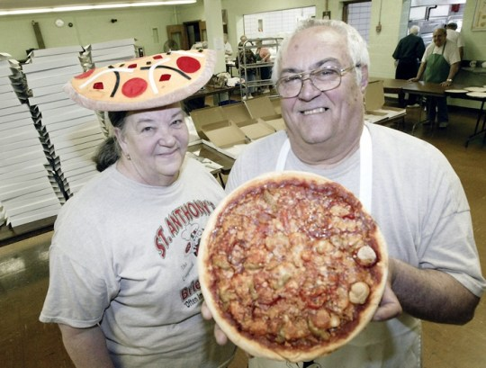 Steve and Marian DeGenaro in the kitchen at St Anthony Church in Youngstown Friday 4-24-09. They and about 25 volunteers make and sell several hundred pizza's/week as a church fundraiser. See more at: http://www.vindy.com/photos