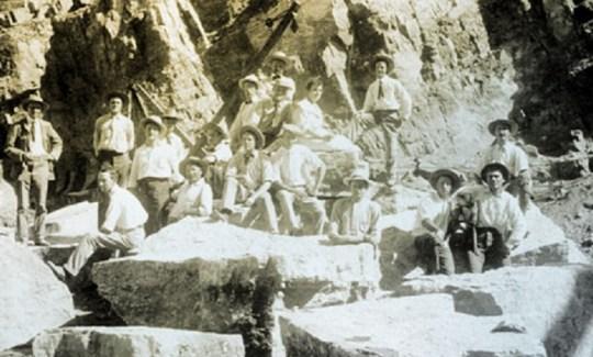 . Here twenty-six Italian stonemasons pose for the Reclamation Service photographer Walter J. Lubken in 1906.