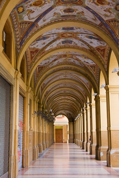 Decorated old portico with columns in Bologna, Italy