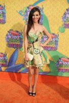 Victoria Justice, in an Atelier Versace dress and Jimmy Choo shoes