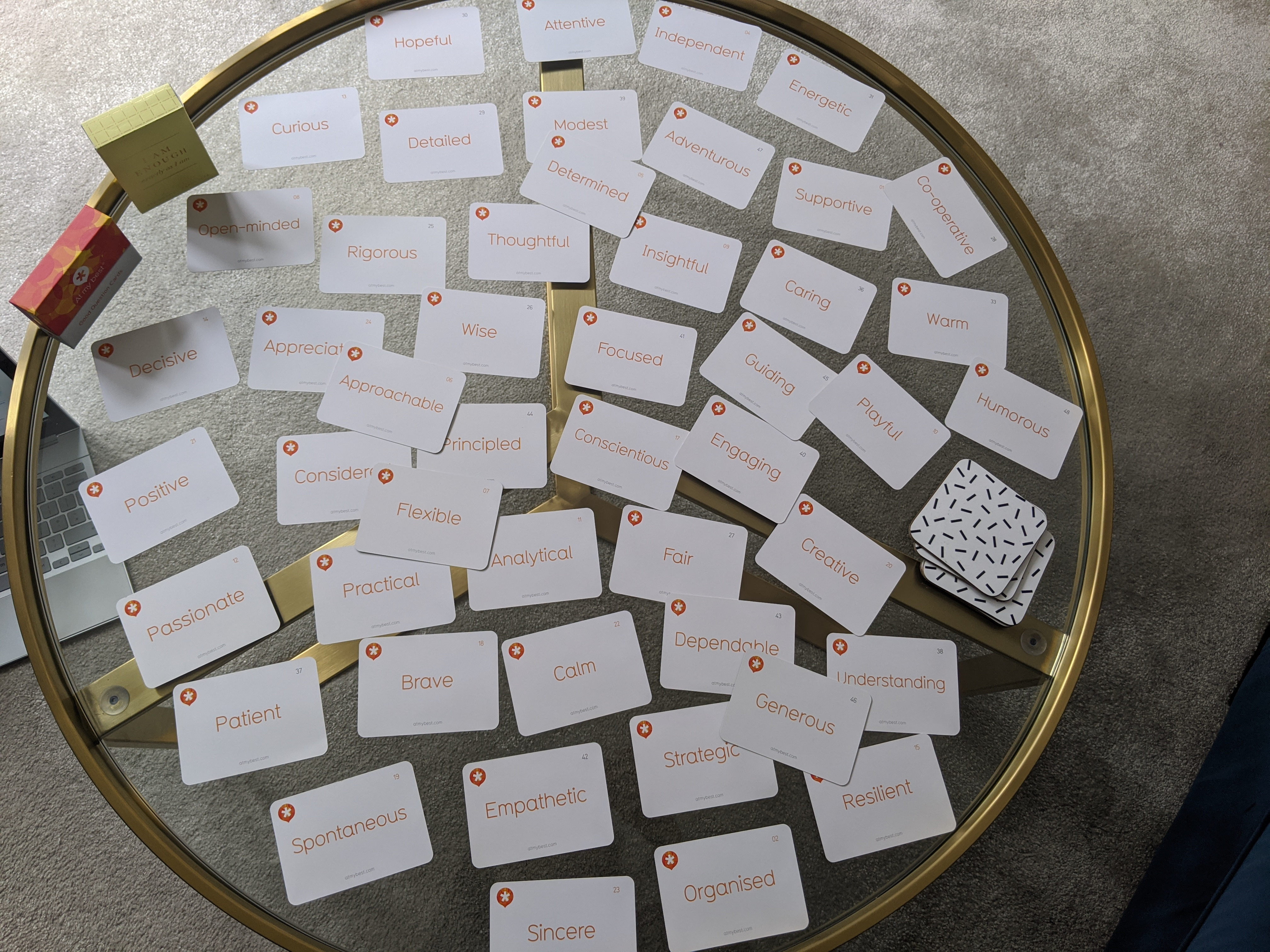 Strengths cards scattered on a round glass table