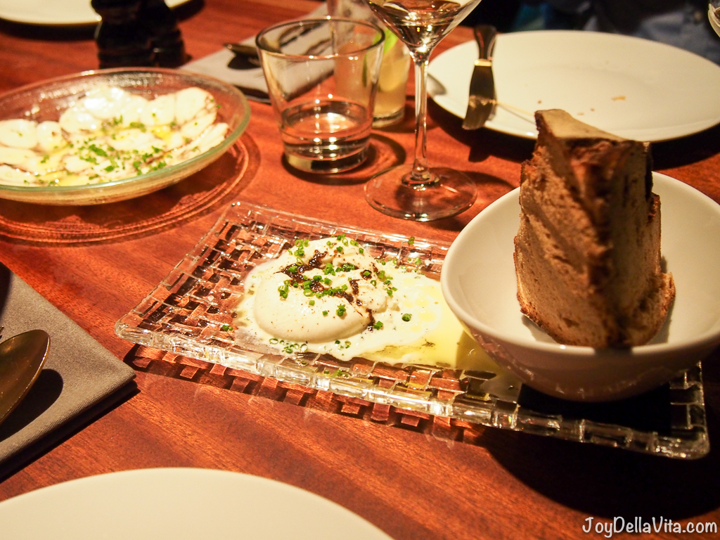 CRACKERS Berlin Burrata with black truffles, cabernet sauvignon vinegar and rye bread