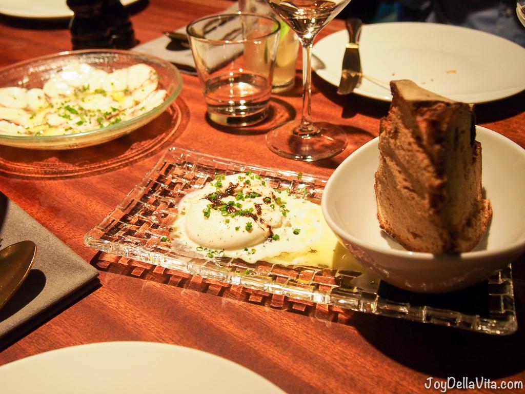 CRACKERS Berlin Burrata with black truffles, cabernet sauvignon vinegar and rye bread