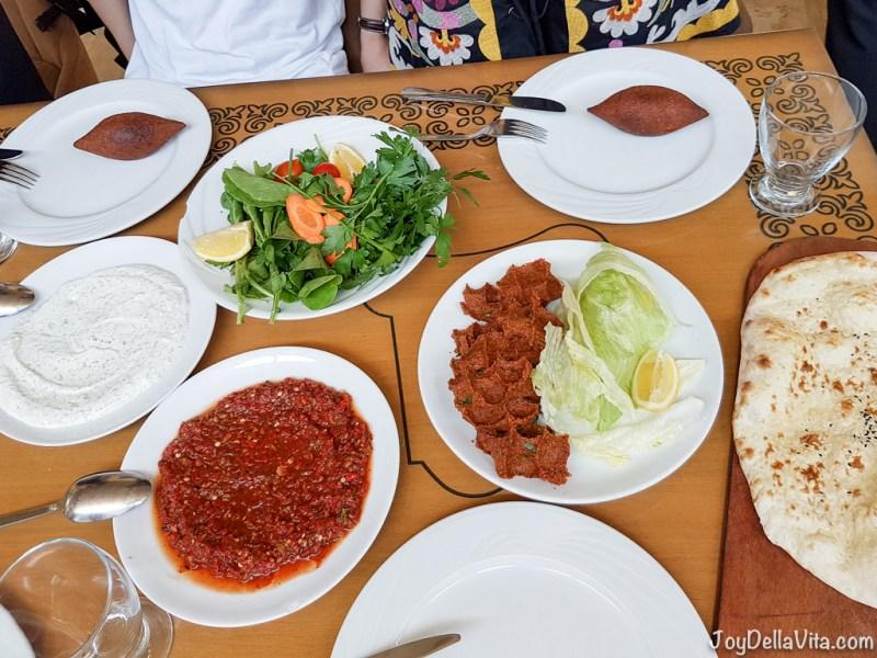Çiğ Köfte, İçli Köfte, salad, yoghurt and a spicy dip as shared starters
