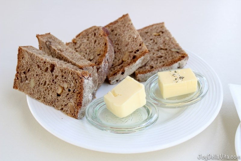 fresh bread with nuts and butter as complimentary appetizer