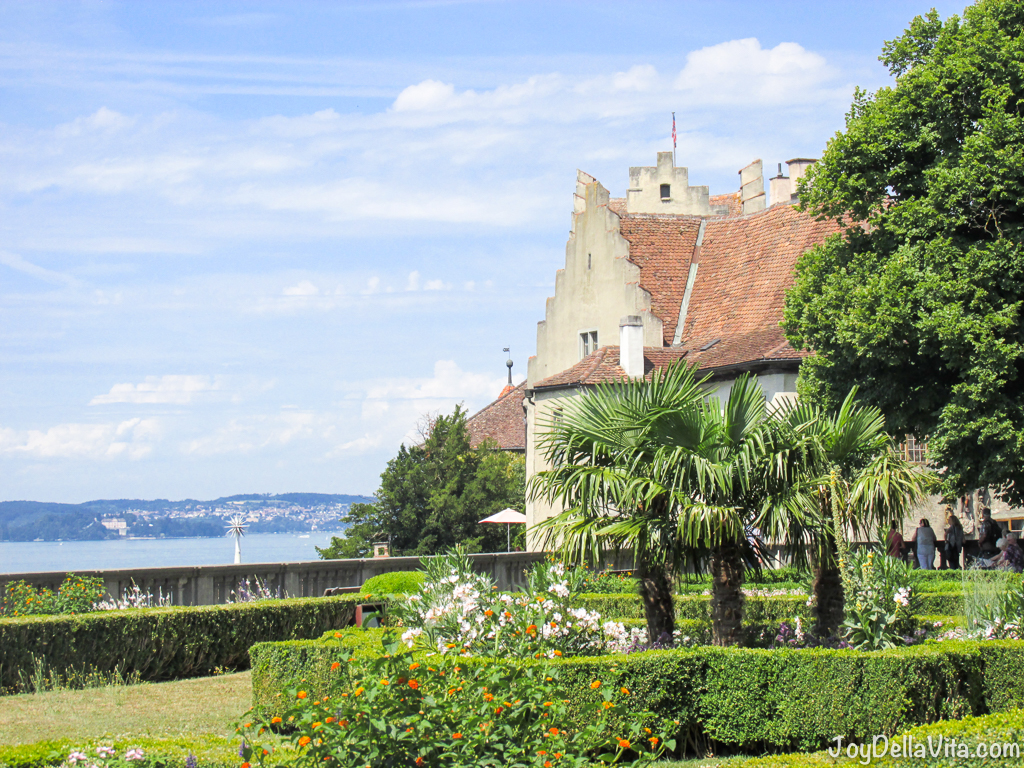 garden of the new castle, with the old castle of meersburg in the background