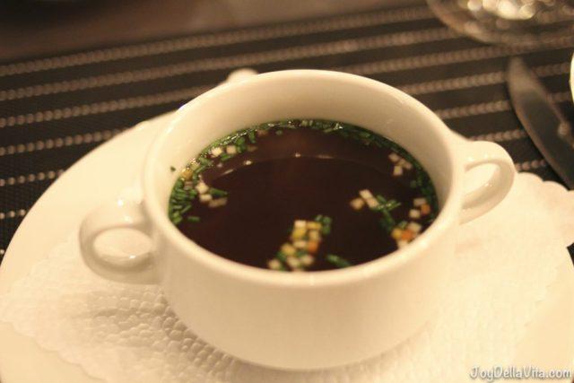 Consommé with vegetable brunoise Restaurant Falkenburg StGallen Travelblog JoyDellaVita