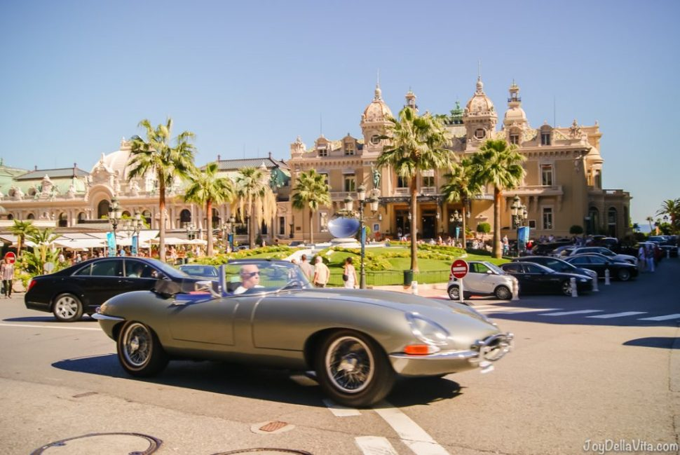 The Casino in Monaco is a magnet to all luxury and beautiful, especially in Summer - here a vintage Jaguar E-Type in front of the Casino with palm trees and cloudless sky