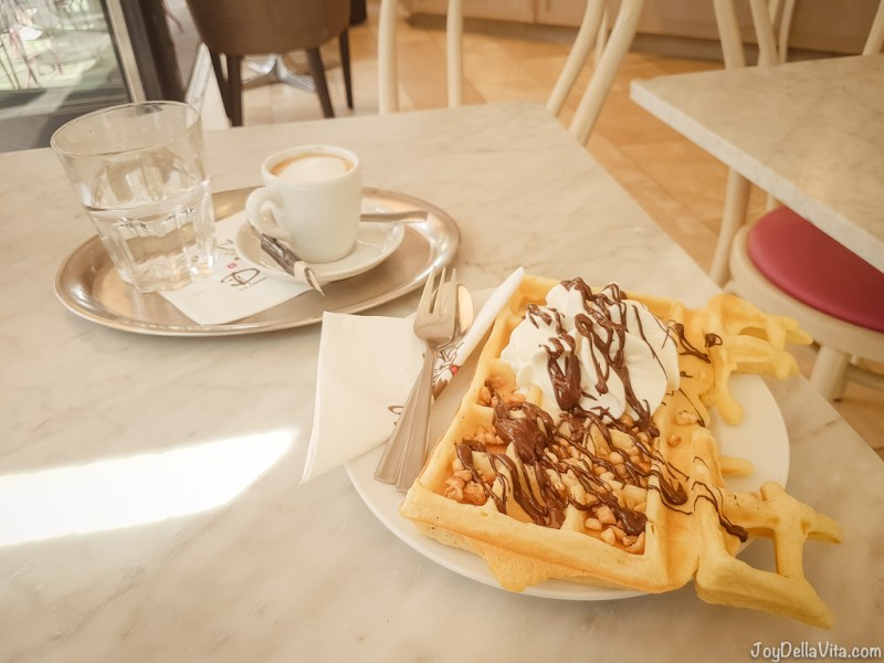 Hot Belgian Waffle with pecan nuts, chocolate and whipped cream - Dulce Chocolate & Icecream Waffle Cologne Willy-Millowitsch-Platz