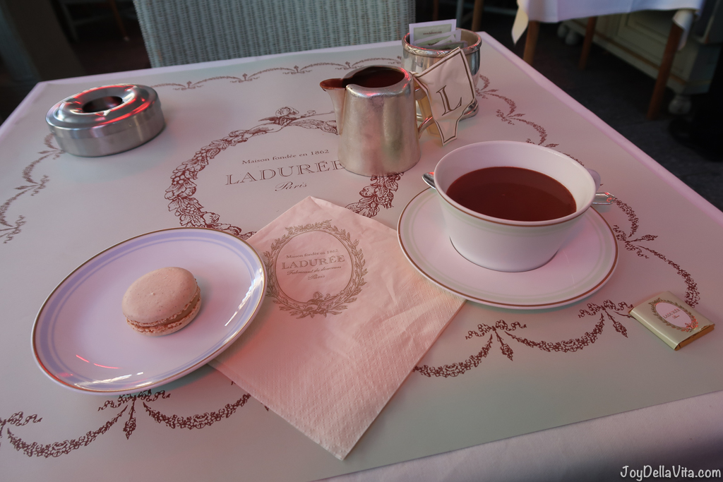 Hot Chocolate and a Vanilla Macaron at Laduree Champs Elysees Paris