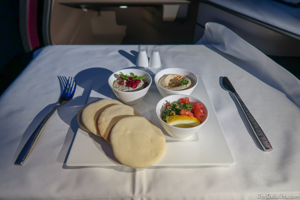 Arabic mezze plate with Hummus Tabbouleh Baba Ghanoush Qatar Airways Qsuite Business Class