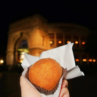 Arancini fried Rice Ball in front of Politeama Palermo