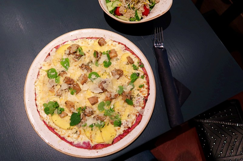 Pink Pizza with potatoes, mushrooms and cheese and a small side salad