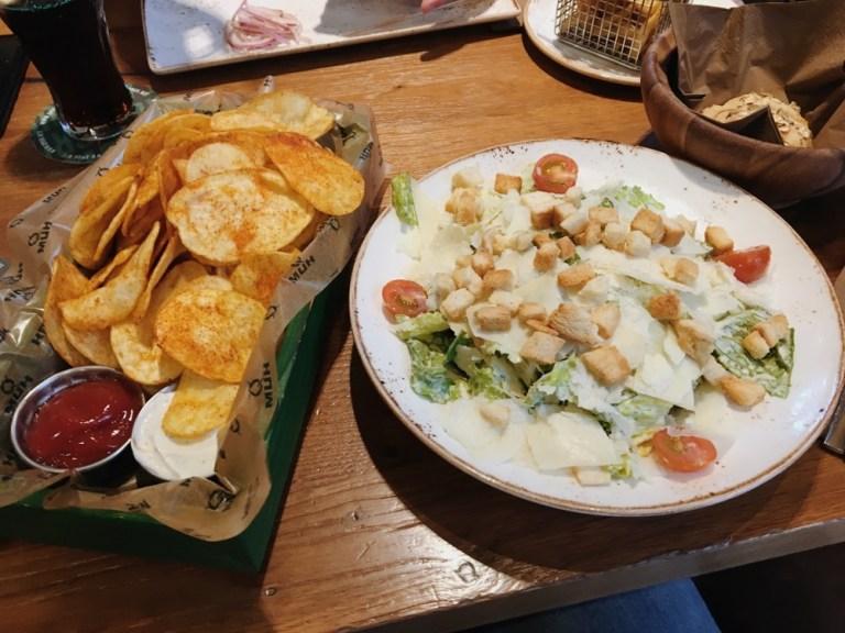 Crispy chips and caesar salad at QMUH in Ravensburg, Oberschwaben, Germany