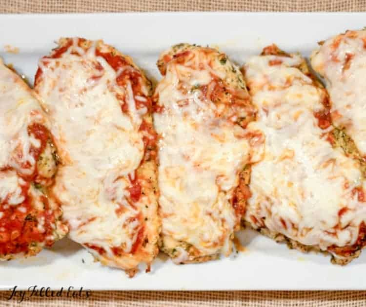 white plate with baked chicken parmesan