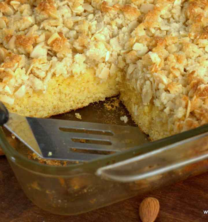 Almond Crumb Cake Recipe with a slice missing