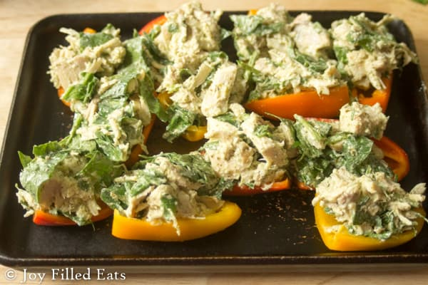 These Mini Chicken Stuffed Peppers are packed with good stuff. Chicken, cilantro, cheese, yogurt, & spinach. They are low carb, gluten/grain free, & THM S.