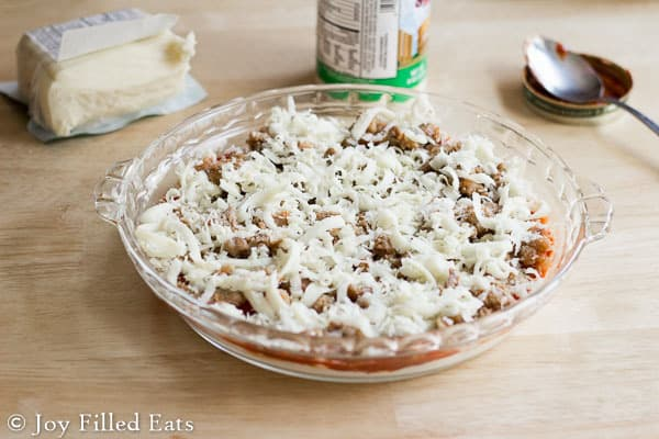 The Sausage Pizza Dip topped with shredded mozzarella.