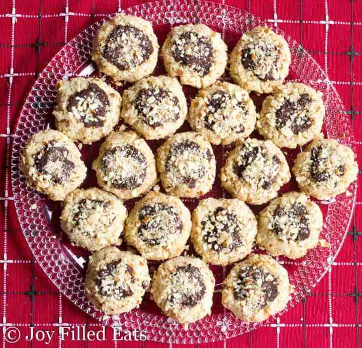 Almond Crunch Chocolate Thumbprint Cookies on a glass circular plate