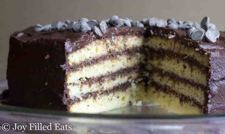 Classic Yellow Cake with Chocolate Icing missing a slice so you can see the layers