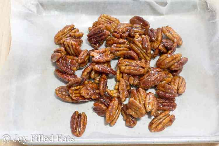 wet and sticky Glazed Pecans on waxed paper