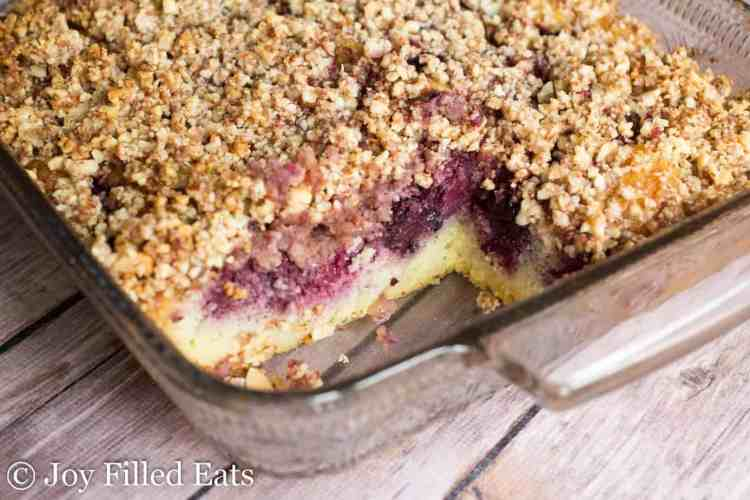 a close up of the inside of the blackberry coffee cake with almond crumb topping