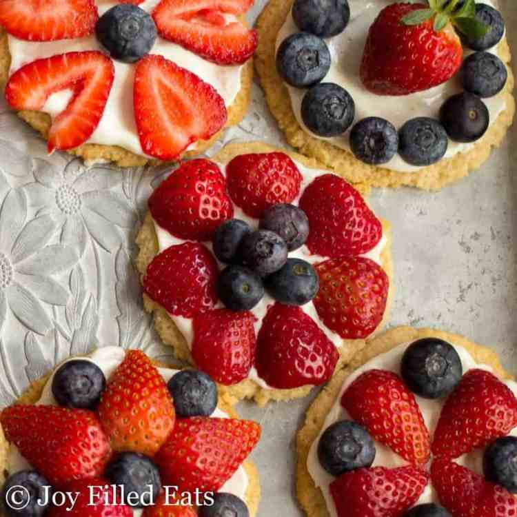 A close up of the healthy fruit pizza cookies on a metal tray