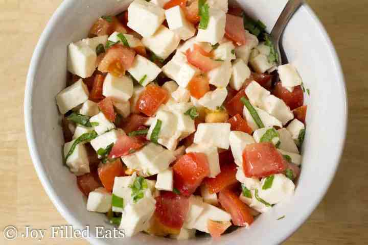 Caprese salad in a white bowl