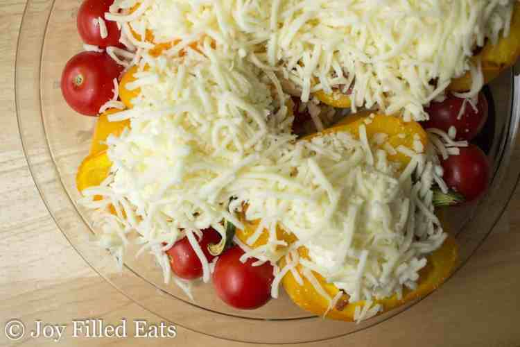 White Lasagna Stuffed Peppers topped with cheese