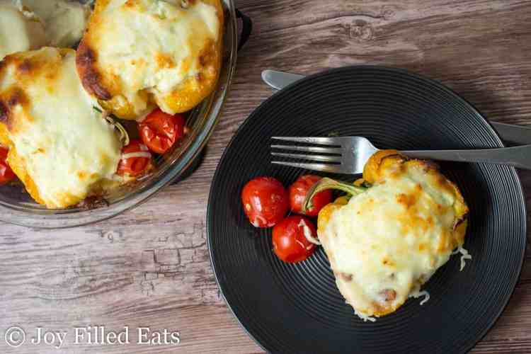White Lasagna Stuffed Peppers in a glass pie plate and on a black plate